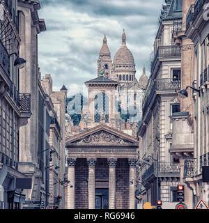 Sacre coeur viewed from Rue Laffitte street in Paris - Stock Photo