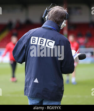 BBC radio journalist broadcasting during the EFL League 2 match between Swindon Town and Crawley Town at the County Ground in Swindon. 26 January 2019. Editorial use only. No merchandising. For Football images FA and Premier League restrictions apply inc. no internet/mobile usage without FAPL license - for details contact Football Dataco - Stock Photo