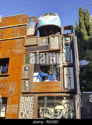 Unusual street art shows this house in the Rainbow Street of Amman. The old motor vehicles, including a VW van, fill a complete corner of the multi-storey building on the popular promenade. (02 November 2018)   usage worldwide - Stock Photo