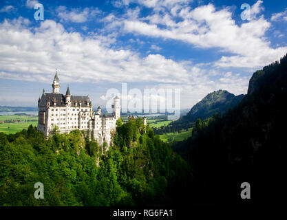 Neuschwanstein Castle has a grand view from the the foothills of the Alps in Bavaria, Germany. - Stock Photo