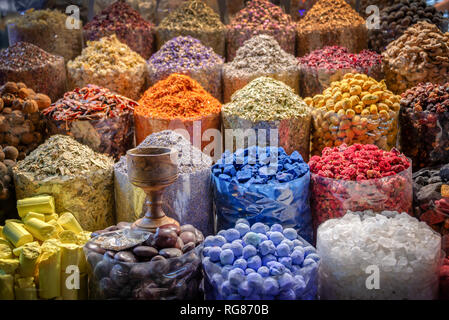 Colorful piles of spices in Dubai souks, United Arab Emirates - Stock Photo