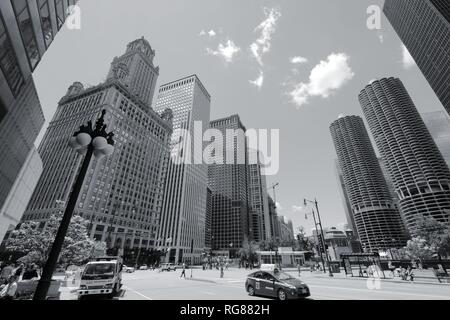 CHICAGO, USA - JUNE 28, 2013: People visit downtown in Chicago. With 2.7 million residents, Chicago is the 3rd most populous city in the USA. - Stock Photo