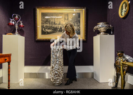 London,UK. 28th Jan 2019. A monumental sculptural silver vessel part of the  annual gentleman's library sale at Bonhams Montpelier Street, Knightsbridge being held on 30th January 2019.  Credit: Claire Doherty/Alamy Live News - Stock Photo