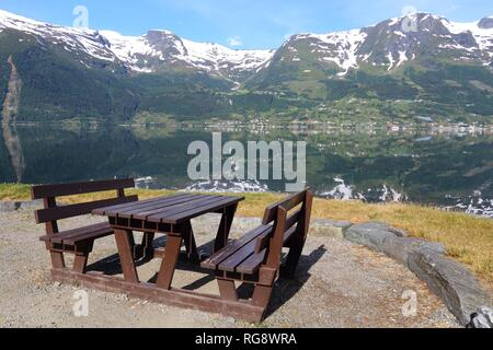 Norway fiord landscape - part of Hardanger Fjord called Sorfjord. Morning view with rest place picnic table. - Stock Photo