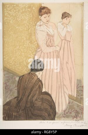 The Fitting. Artist: Mary Cassatt (American, Pittsburgh, Pennsylvania 1844-1926 Le Mesnil-Théribus, Oise). Dimensions: plate: 14 13/16 x 10 1/8 in. (37.6 x 25.7 cm)  sheet: 16 13/16 x 11 3/4 in. (42.7 x 29.8 cm). Date: 1890-91. Museum: Metropolitan Museum of Art, New York, USA. - Stock Photo