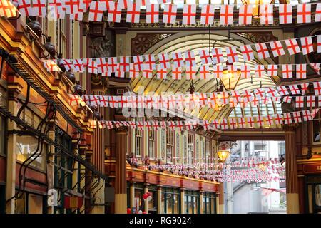 LONDON, UK - APRIL 22, 2016: Saint George's Day decorations in Leadenhall Market, London. Saint George is the patron saint of England. - Stock Photo