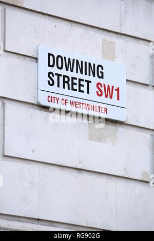 LONDON, UK - APRIL 23, 2016: Downing Street sign in London, UK. 10 Downing Street is the office of British Prime Minister. - Stock Photo
