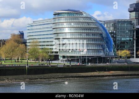 LONDON, UK - APRIL 23, 2016: People walk next to the City Hall (GLA) in London. London is the most populous city and metropolitan area of the European - Stock Photo