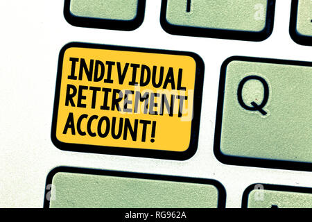 Writing note showing Individual Retirement Account. Business photo showcasing Invest and earmark funds for retirement Keyboard key Intention to create - Stock Photo