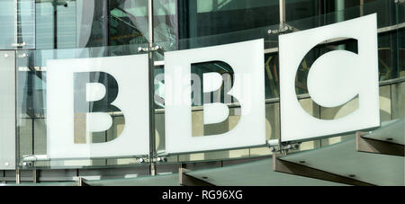 Close up BBC British Broadcasting Corporation sign logo & glass cladding on new modern HQ extension building at Broadcasting House London England UK - Stock Photo