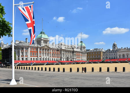 Security bollards protection on Horse Guards Parade Ground summer events & historic old building facades union jack flag in iconic London England UK - Stock Photo