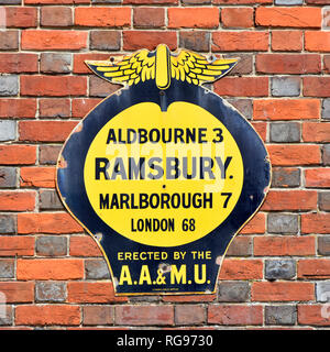 Old fashioned AA & MU road sign fixed to brick wall in Ramsbury village in Wiltshire with distances to Aldbourne  Marlborough and London England UK - Stock Photo
