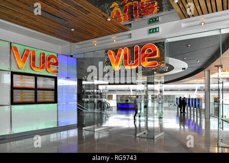 Signs in entrance to Vue cinema in indoor shopping mall with people in foyer Westfield shopping centre Stratford City Newham East London England UK - Stock Photo