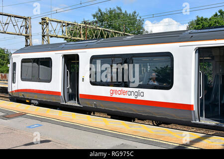Greater Anglia commuter train with passenger access doors open waiting at platform to leave Shenfield Elizabeth line railway station Essex England UK - Stock Photo