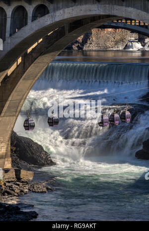 One of the attractions left from the worlds fair in 1974, the gondola skyride over Spokane Falls gives people a unique perspective of the crown Jewel  - Stock Photo