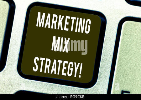 Conceptual hand writing showing Marketing Mix Strategy. Business photo text Set of governable tactical marketing tool company use Keyboard key Intenti - Stock Photo