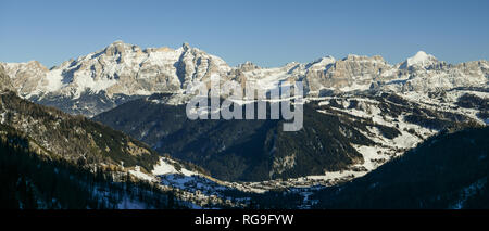 Snowy landscape of val Badia in the Dolomites, South Tyrol, Italy seen from Gardena pass - Stock Photo