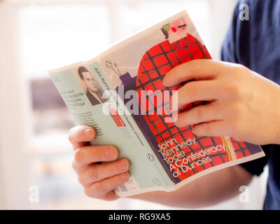 Male hands holding Book: A Confederacy of Dunces by John Kennedy Toole. Published by Penguin Modern Classics. - Stock Photo