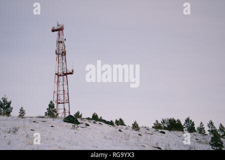Antennas of cellular communication against the background of a decline - Stock Photo