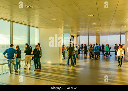 MONTEVIDEO, URUGUAY, OCTOBER - 2018 - Group of people watching the view of the city at antel tower viewpoint in montevideo city, Uruguay - Stock Photo