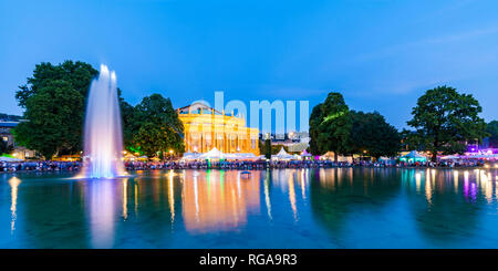 Germany, Stuttgart, palace garden, Eckensee, state theatre, opera house during summer party, blue hour - Stock Photo