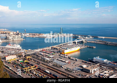 Barcelona, Spain - January 21, 2019: View from Montjuic Castle of Barcelona industrial port docked with ships - Stock Photo