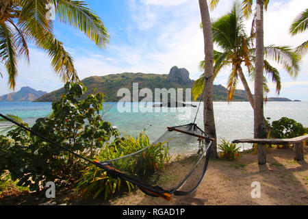 Relax in a hammock on the island of Kuata, in front of Wayasewa Island, Yasawa Islands, Fiji - Stock Photo