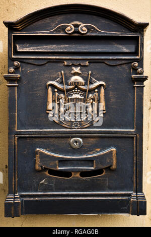 private cast-iron mail slot letter box with decoration - Stock Photo