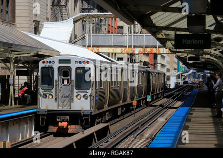 Chicago 'L' trains running on elevated railroad tracks in the Loop of Chicago. Illinois.USA - Stock Photo