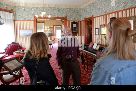 Visitors with guide in the living room of Ernest Hemingway's birthplace. 339 N. Oak Park Avenue.Oak Park. West of Chicago. Illinois. USA - Stock Photo