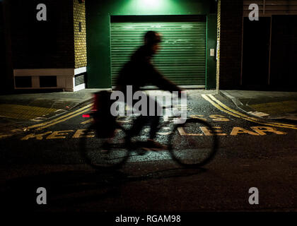 fire access keep clear, sinageon road infront of green steel roller shutter garage door - Stock Photo