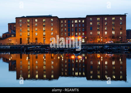 The Atlantic Pavilion and buildings of the Royal Albert Dock reflect in the Salthouse Dock in Liverpool, England. The dock on the River Mersey is the  - Stock Photo