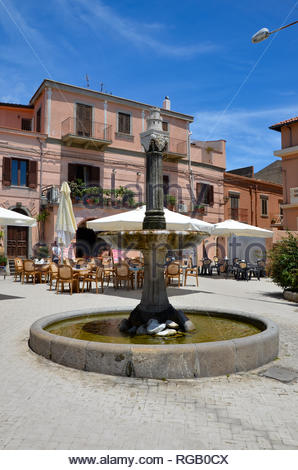 The medieval mountain village of Forza dAgro in Sicily, historic village square with ancient fountain, movie location of Godfather, blue sky, sunny - Stock Photo