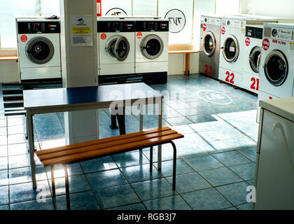 public laundromat empty interior - Stock Photo