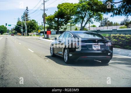 April 22, 2018 Santa Clara / CA / USA - Black Tesla Model S driving on a street in Silicon Valley - Stock Photo
