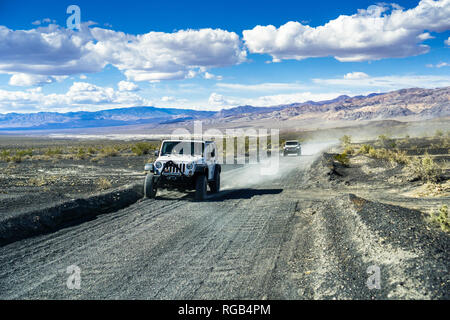 May 27, 2018 Death Valley / CA / USA - Jeep vehicles travelling on an unpaved road through a remote part of Death Valley National Park - Stock Photo