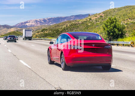 June 10, 2018 Los Angeles / CA / USA - The new Model 3 Tesla driving on the freeway, Los Angeles county - Stock Photo