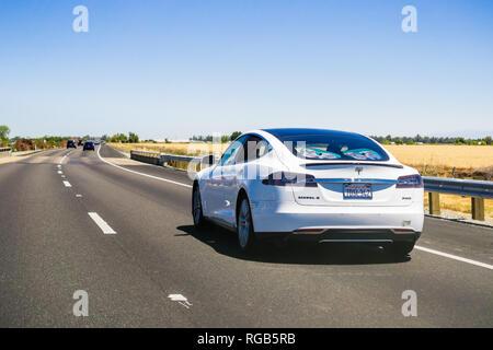 June 23, 2018 Redding / CA /USA - Tesla Model S driving on the interstate - Stock Photo
