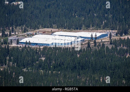 June 25, 2018 Weed / CA / USA - Aerial view of Crystal Geyser Alpine Spring Water by CG Roxane facility, surrounded by forests - Stock Photo