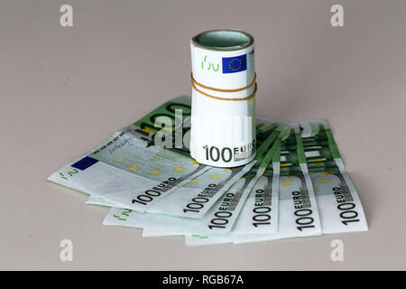 Banknotes worth 100 euros are on the table. - Stock Photo