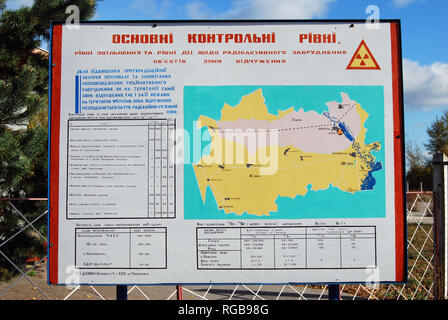 Signposts at the edge of the Chernobyl Exclusion Zone in Ukraine - Stock Photo