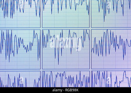 Computer diagram oscillation display of multiple CPU cores working at high frequency on the powerful workstation during high-load data environment - Stock Photo
