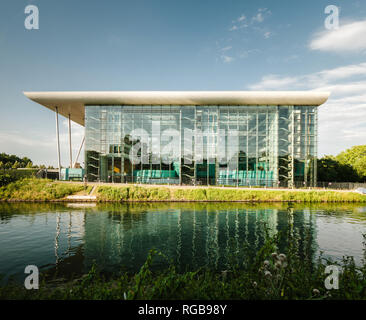 Council of Europe Agora building with glass facade and Ill river canal in Strasbourg, France - Stock Photo