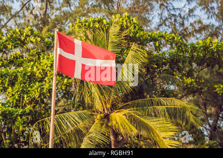 Flag of Denmark against the backdrop of palm trees - Stock Photo