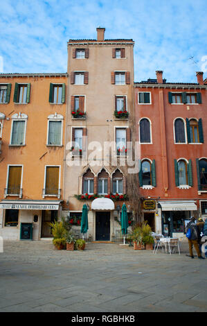 Quaint restaurant and hotel located in a small courtyard buried in the maze known as Venice, Italy. - Stock Photo