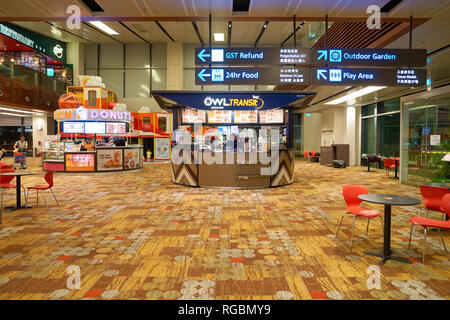 SINGAPORE - CIRCA AUGUST, 2016: Owl Transit at Singapore Changi Airport. Changi Airport is one of the largest transportation hubs in Southeast Asia. - Stock Photo