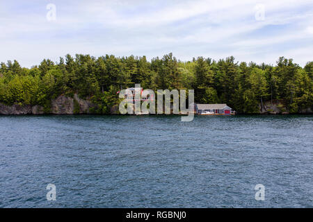 Thousand Islands National Park, Saint Lawrence River, Ontario, Canada, June 17, 2018: Beautiful Houses on the banks of the Archipelago in summer - Stock Photo