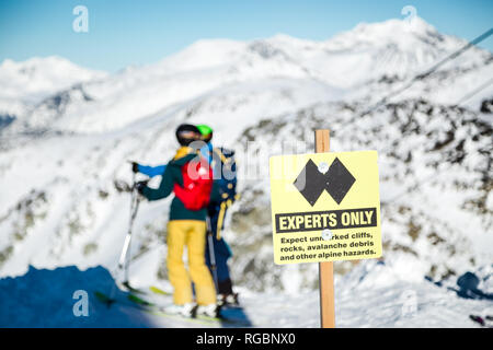 A experts only sign indicating a double black diamond run on the top of Blackcomb mountain. - Stock Photo
