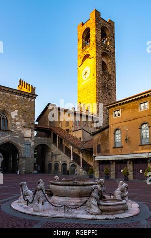 Campanone Civic Tower at main square Piazza Vecchia in Upper Medieval Town in Bergamo - Stock Photo