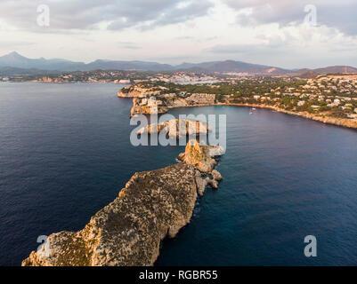 Spain, Mallorca, Region Calvia, Aerial view of Isla Malgrats and Santa Ponca at dusk - Stock Photo